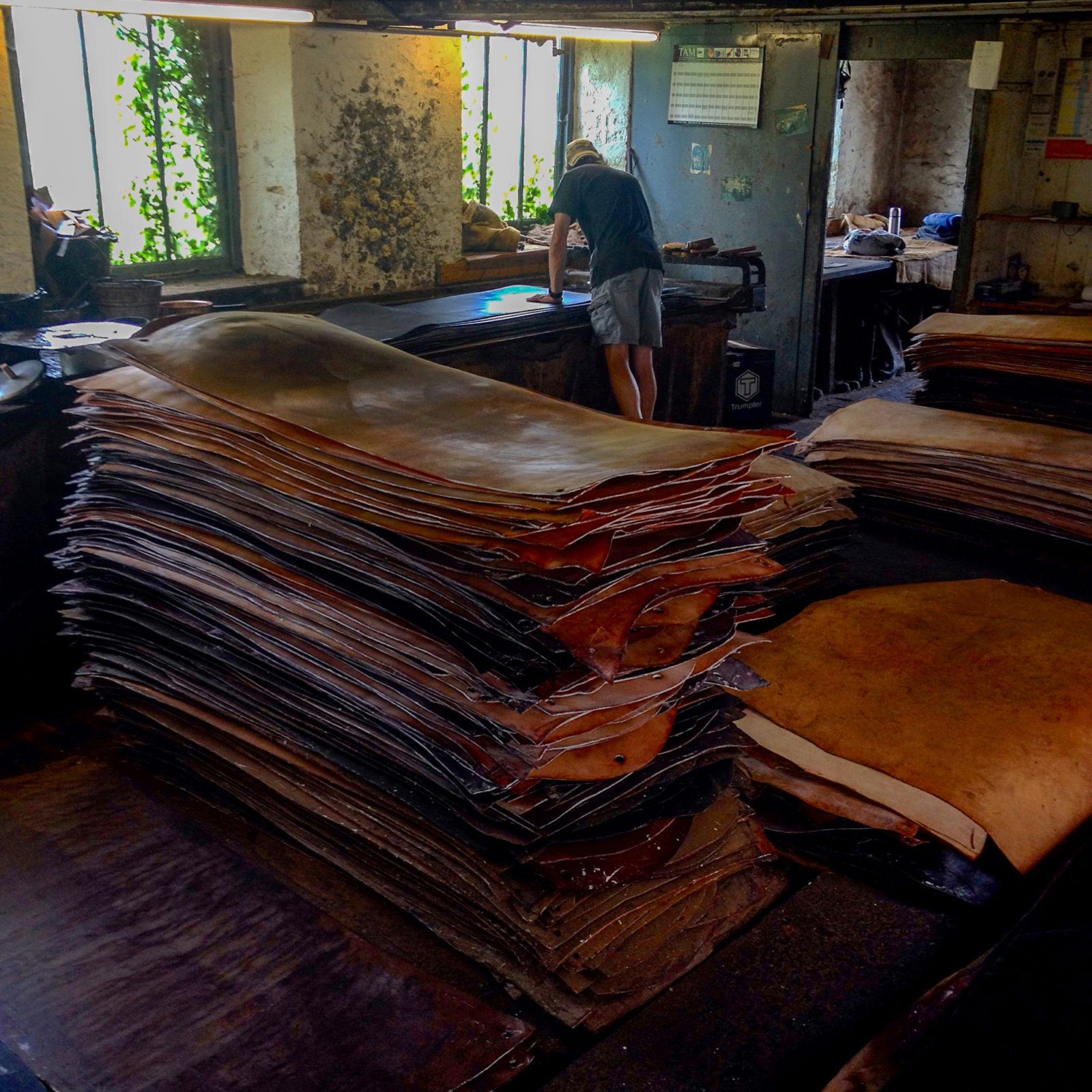 Applying tallow to oak bark tanned leather at J & FJ Baker Ltd